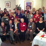 Merrymakers at the JASNA Christmas party pose for a photo